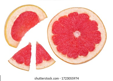 Slices of grapefruit isolated on the white background, flat lay, top view.