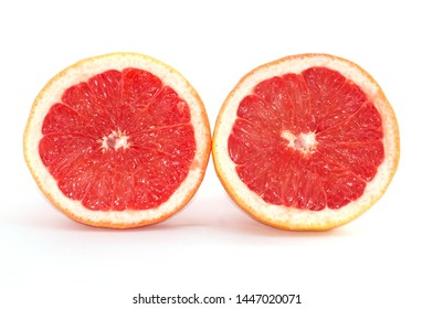 Slices of grapefruit macro, closeup on white background