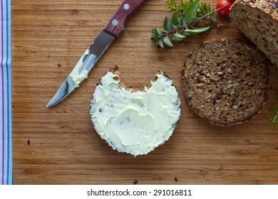 Slices of healthy whole wheat bread with butter spread
