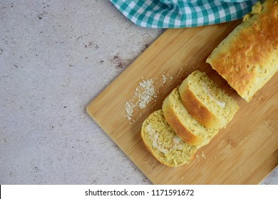 Slices of homemade coconut bread on wooden boars