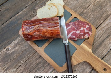 slices of Iberian pork loin, on a rustic wooden background