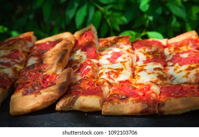 Slices of Italian pizza in a summer day