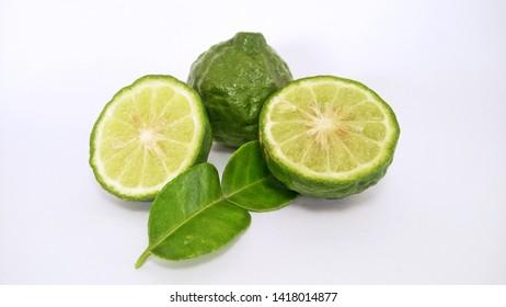 slices of kaffir lime fruit with leaf
