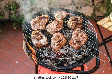 Slices of lamb leg on the grill