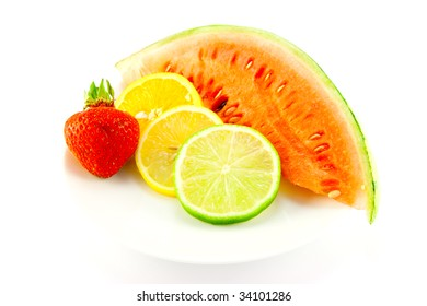 Slices of lemon, lime and orange with a ripe red strawberry and slice of juicy watermelon on a white background