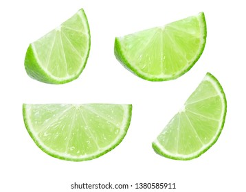 Slices of lime isolated on white background.