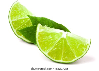 slices of lime with leaves isolated on white background