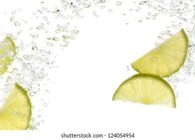 slices of lime in water isolated on white