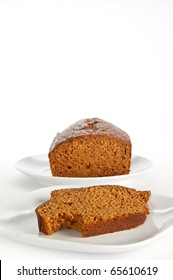 Slices and loaf of freshly homemade pumpkin bread on white, isolating background (vertical)