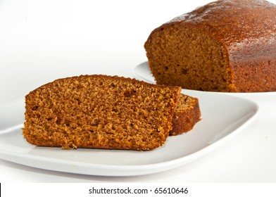 Slices and loaf of freshly homemade pumpkin bread on white, isolating background