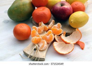 slices of mandarin, lemon, apple and mango.
