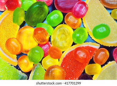 slices of marmalade and colorful lollipops