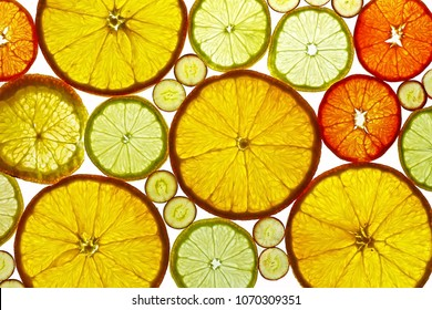 Slices of orange lemon and grapes