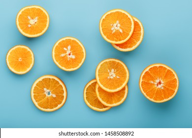 Slices and slices of orange pulp on a bright blue background as a textural background, the substrate. Full screen Flat lay, top view. Food background. Citrus pattern. Pop art, flat lay, top view