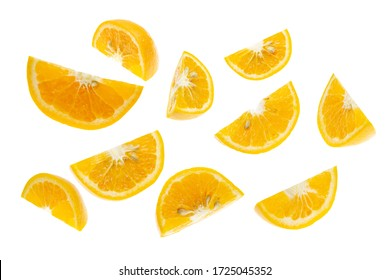 Slices of orange or tangerine isolated on white background. Flat lay, top view. Fruit composition