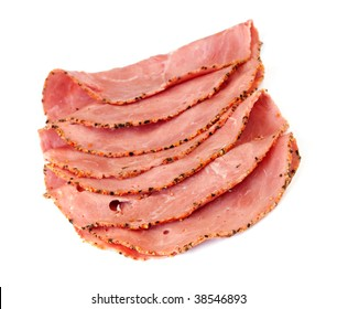 Slices of pastrami, isolated on white background.