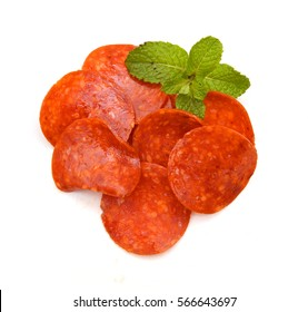 Slices of pepperoni on white background