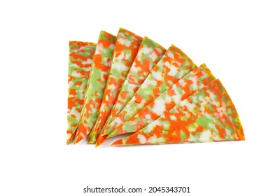 Slices of piquant spicy multicolored cheese isolated on white background