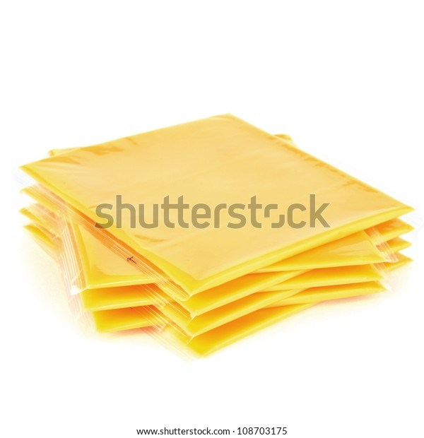 Slices of processed American cheese on white background