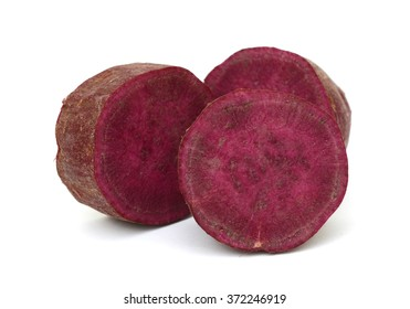 Slices of purple sweet potato isolated on the white background