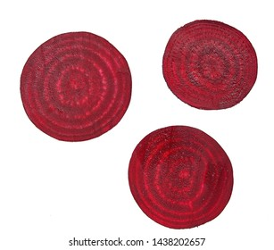 Slices of red beetroot against white background. Fresh young sliced beets.