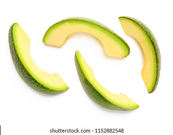 Slices of ripe avocado on white background, flat lay