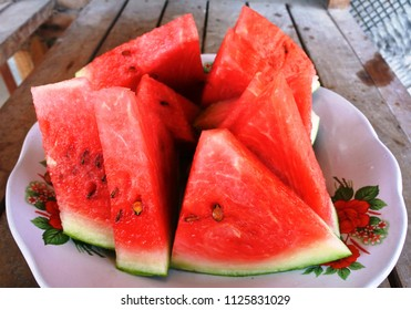 Slices of ripe watermelon arrange on a plate