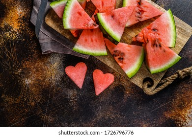 Slices of ripe watermelon in the shape of a heart. The concept of love for watermelon. Selective focus