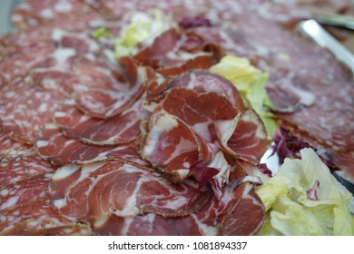 Slices of salami and capocollo, traditional Italian and Corsican pork cold cut