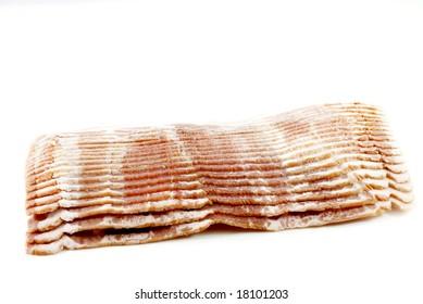 Slices of smoked pork bacon on white background
