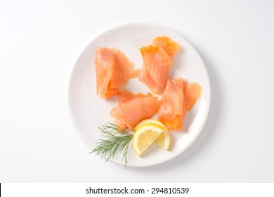 slices of smoked salmon on white plate