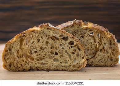 Slices of sourdough bread on wooden board. Healthy food. Artisan bread crumb texture.