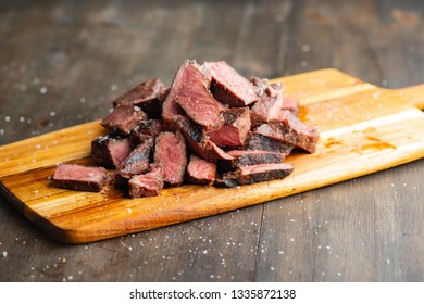 Slices of steak on a cutting board ready to be served