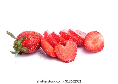 Slices of strawberries placed over white background