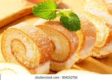 Slices of sweet. creamy roll on a cutting board