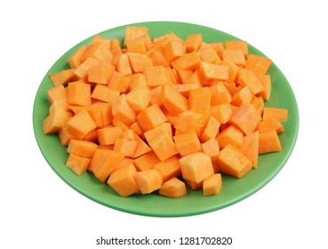 Slices of sweet orange pumpkin on a green plate. Isolated on white studio closeup  shot