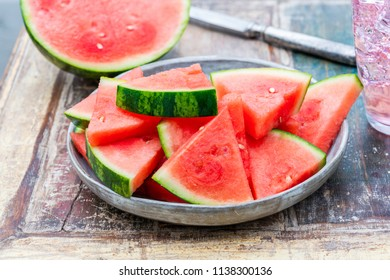 Slices of sweet, refreshing watermelon on a garden table. Summer outdoor eating. - Shutterstock ID 1138300136