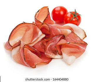 Slices of tasty spanish ham on white background