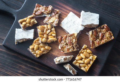 Slices of turron on the wooden board