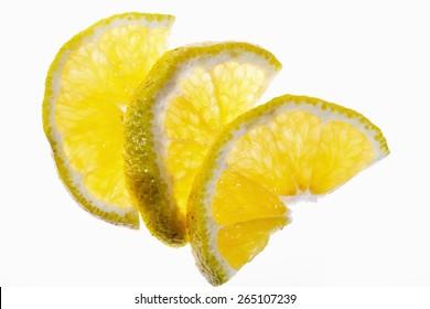 Slices Of Ugli Fruit On White Background