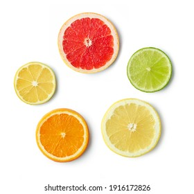 slices of various citrus fruit isolated on white background, top view