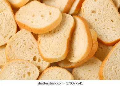 Slices of white bread on white background