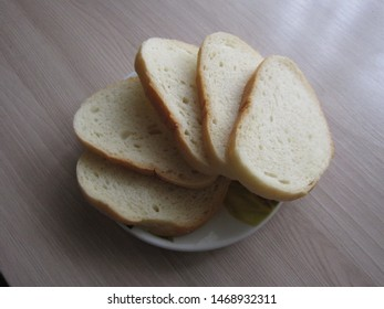 Slices of white bread on a small porcelain plate