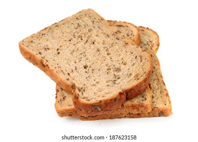 Slices of wholemeal seeded brown bread on white background