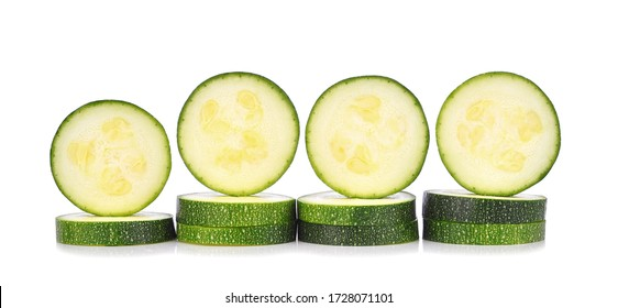 Slices zucchini isolated on white background.