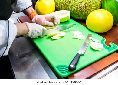 Slicing melons and other fruit on cutting board