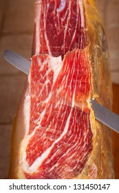 Slicing Spanish jamon iberico (serrano ham)