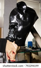 slick oily black pig mask painted in shiny latex black