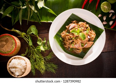 Slide grilled pork salad or beef and Sticky rice is most popular in Thailand's north-east. Street Food. Traditional Thai food, Thailand.