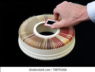 Slide projector carousel tray with hand. Provost, Alberta, Canada.